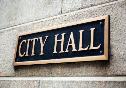city hall sign on building